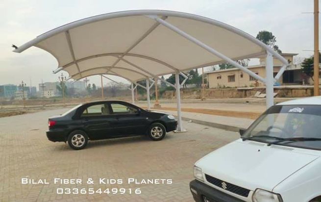 Tensile fabric shades and canopies