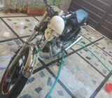 Double silencer unique bike with skull headlight for sale
